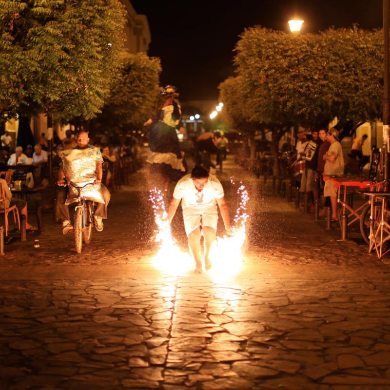 Man in Nicaragua holding sparkler on street