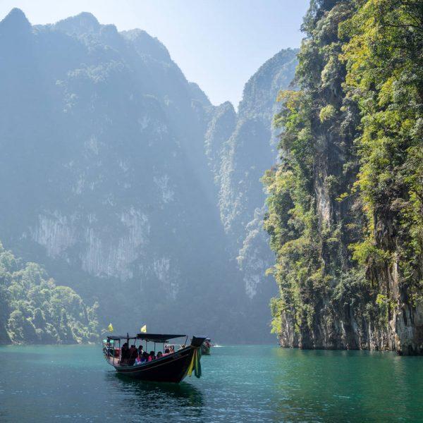Thai boat navigating between islands
