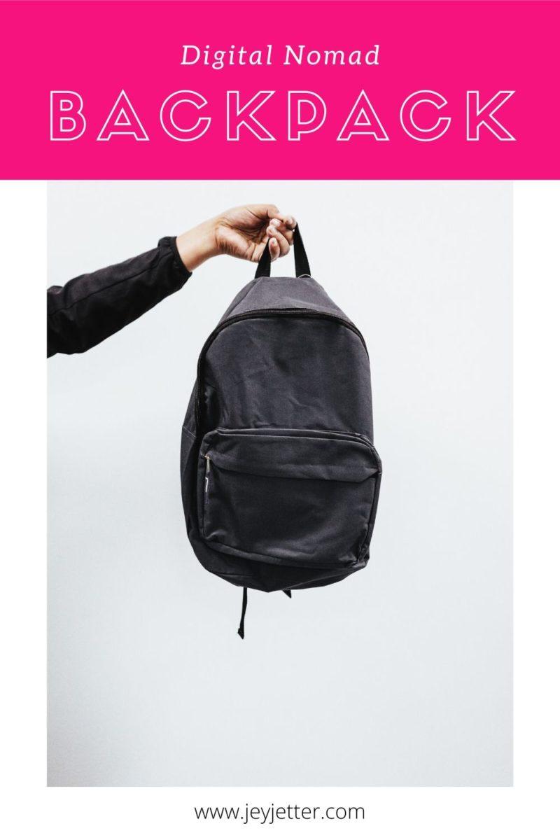 Hand holding black backpack, pin for Pinterest
